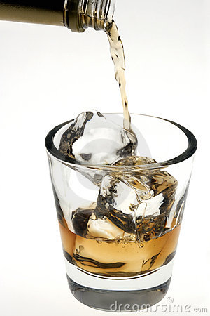 Whiskey being poured over ice