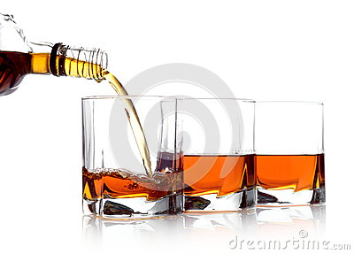 Whiskey poured into three glasses