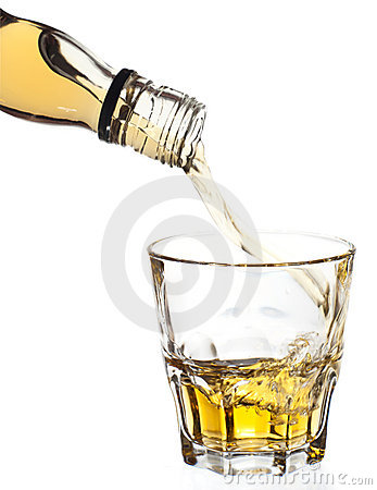Whiskey pouring in glass, clipping path