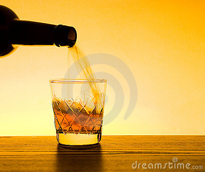 Whisky and Whiskey Being poured