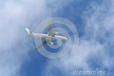 White Airplane over clouds