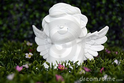 White Angel Ceramic Figurine On Green Grass With White And Purple Flower Free Public Domain Cc0 Image