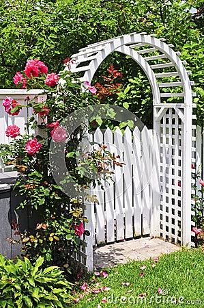 White arbor in a garden