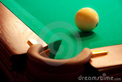A white ball near the billiard pocket