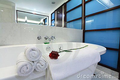 White bathtub with towel