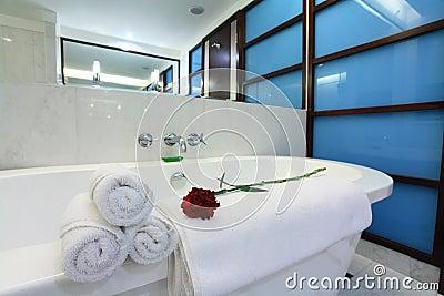 White bathtub with towel