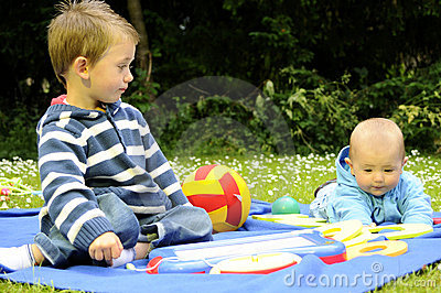 White beautiful children playing in park