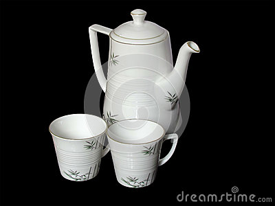 White beautiful tea pot and cups isolated