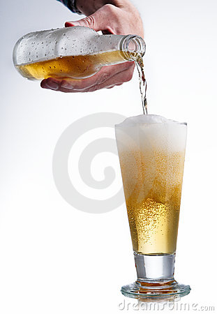 White beer bottle and glass