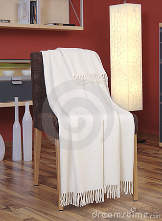 White blanket draped over a chair