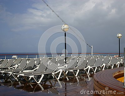White and blue striped deck lounging chairs