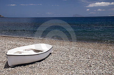 White boat at the beach