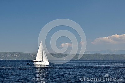 White boat on open blue sea, Croatia Stock Photo