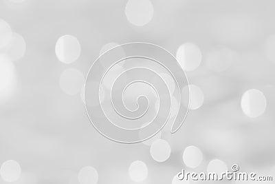White bokeh on a silver background.