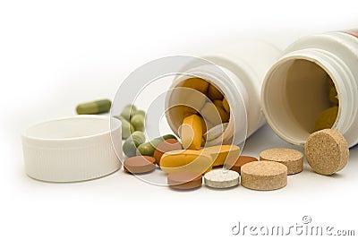 White bottles and pills macro