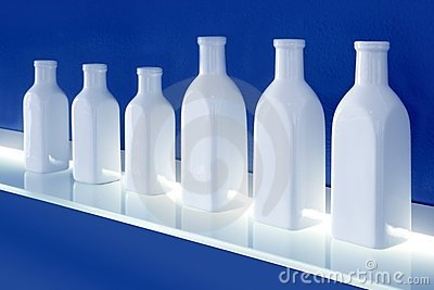 White bottles row on blue background shelf