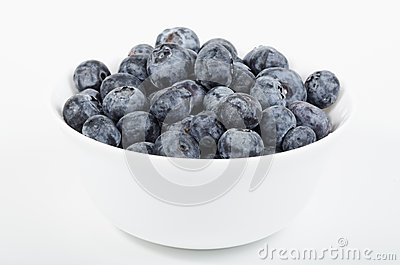 White bowl filled with blueberries
