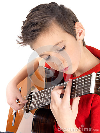 White boy playing on acoustic guitar