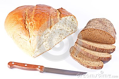 White bread loaf and sliced rye loaf with knife