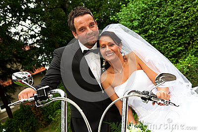 Bride groom on Harley bike