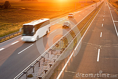 White bus in motion blur on highway