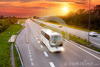 White bus in the rush hour on the highway