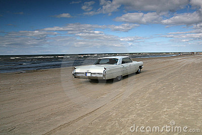 White cadillac on a beach