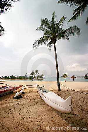 White canoe on tropical beach