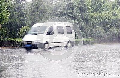 White car in the rain