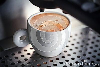 White ceramic cup of fresh espresso with foam