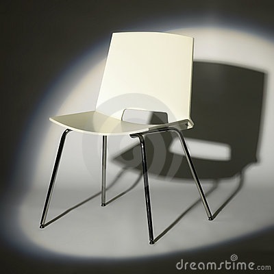 White chair in spotlight