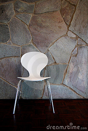 White Chair by stone Wall