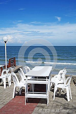 White chair and table on beach
