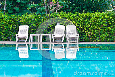 White chairs beside the swimming pool