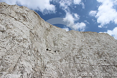 White chalk cliff and blue sky