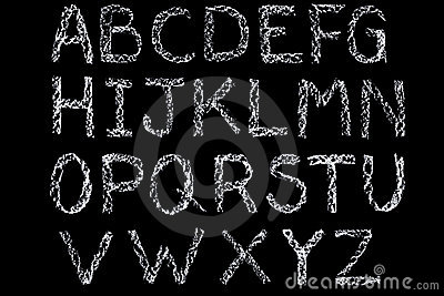 White chalk handwritten alphabet on blackboard