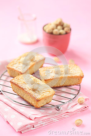 Blondies - White Chocolate Cakes with Macadamia Nuts, on a pink ...