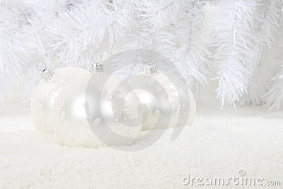 White christmas baubles in snow