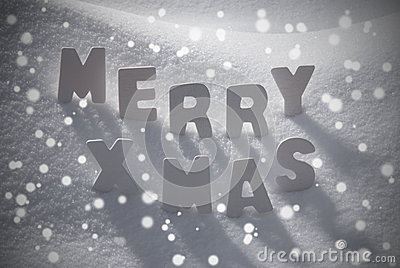 White Christmas Text Merry Xmas On Snow, Snowflakes Stock Photo