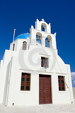 White church, cross, bells Santorini Island Greece