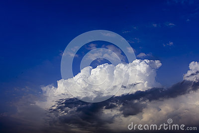 White cloud on blue sky with cloud in front
