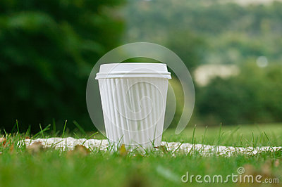A white coffee cup in the grass