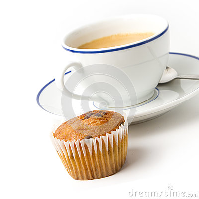 White coffee cup on plate and muffin