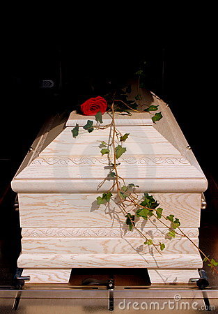 White coffin with rose
