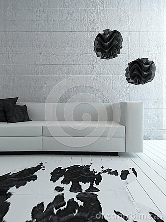 White couch standing in front of concrete wall