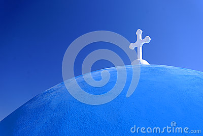 White cross on blue domed church