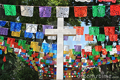 White cross with colorful flags, Mexico
