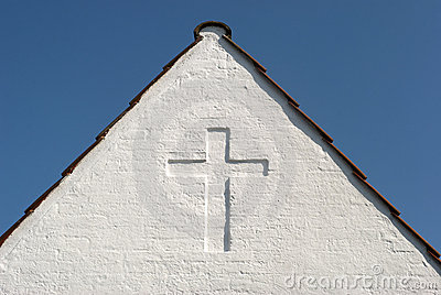 White cross on gable sky blue