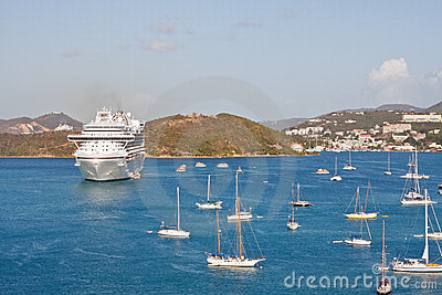 White Cruise Ship in Bay with Many Sailboats