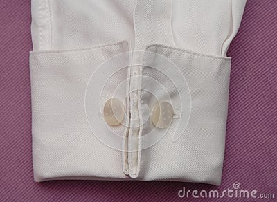 White cuff with cuff link.